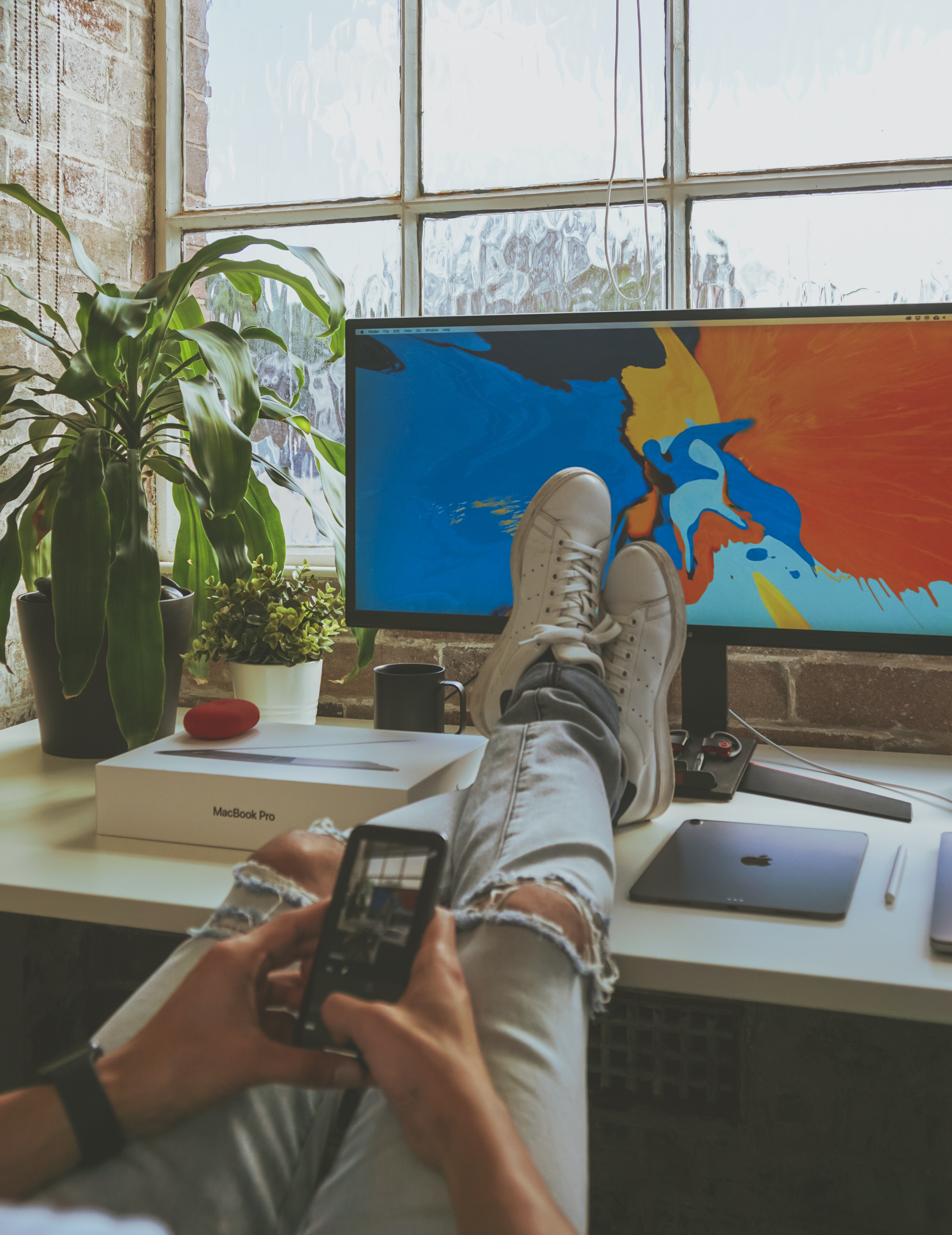 person taking a break from working remotely from home feet up relax