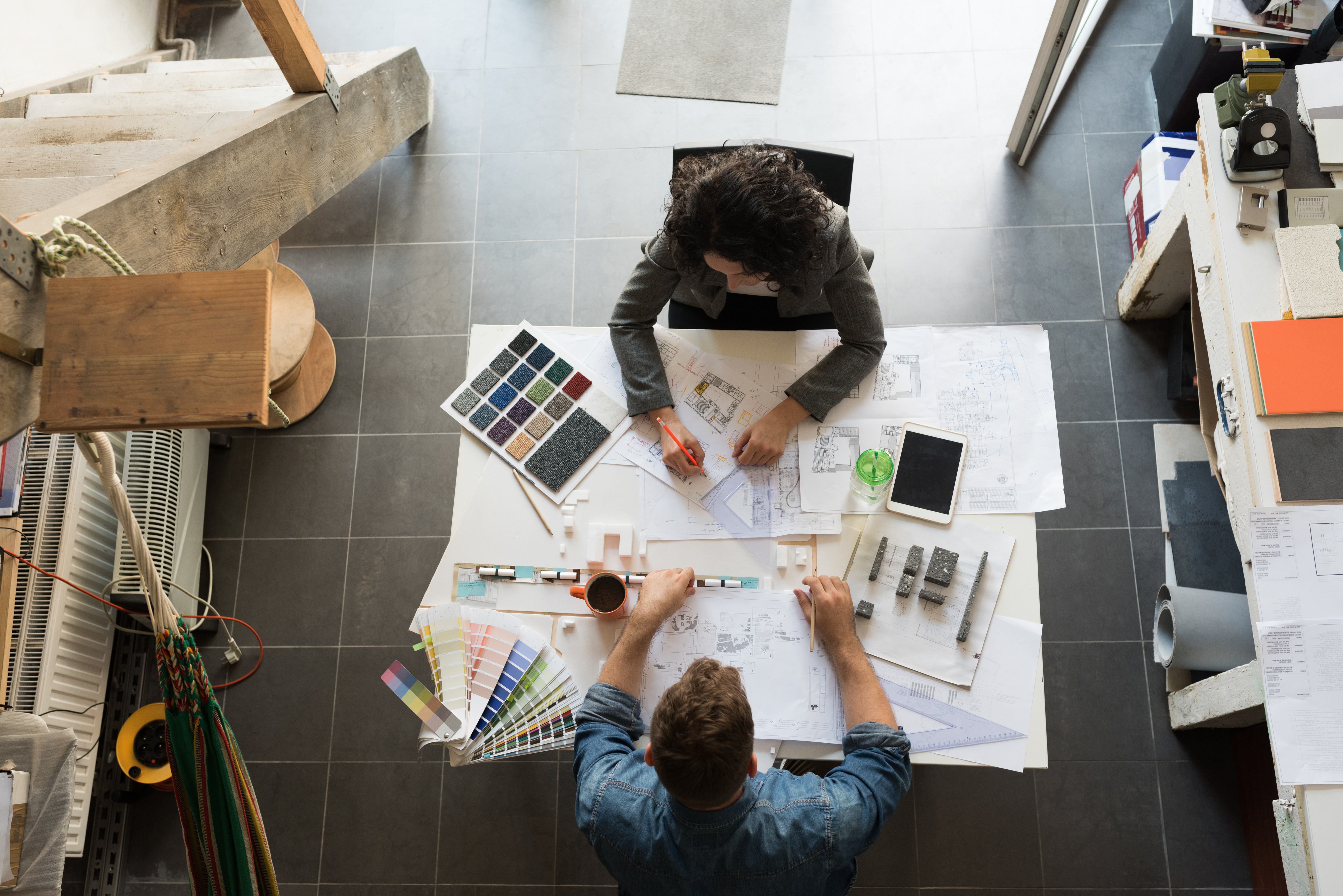 Two people design working together